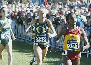 Betsy Saina pulls away from Jordan Hasay and Abbey D'Agostino to win the 2012 NCAA cross country title *2012 NCAA Cross Country Photos