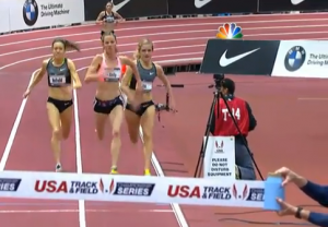Chelsea Reilly (c.) running expertly down the middle/outside of lane one.