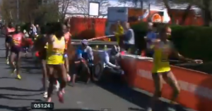 Tiki Gelana gets hit at the 2013 Virgin London Marathon