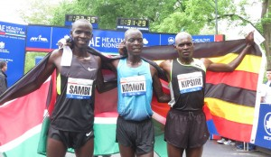 (l. to r.) Stephen Sambu of Kenya (3rd place), Leonard Patrick Komon (1st) and Moses Kipsiro (2nd) after finishing the 2013 Healthy Kidney 10-K (photo by Jane Monti for Race Results Weekly)