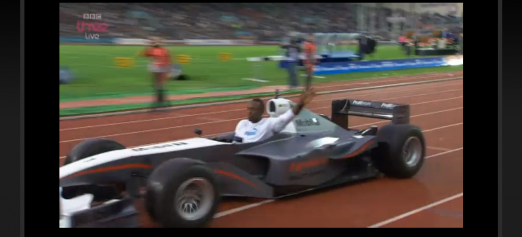 WTF? Pre-race Bolt zoomed around the track in a race car with ExxonMobil all over it