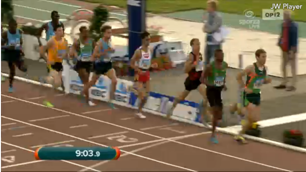 Ben True leading the main chase pack with 4 laps to go