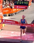 Ed Whitlock at the end of his most famous marathon. Photo via Canada Running Series.