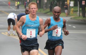 Matt Tegenkamp (l) and Abdi Abdirahman battle it out in the final 2 kilometers of the 2013 USA 20-K Championships at the Stratton Faxon New Haven Road Race; Shadrack Biwott is behind Tegenkamp (photo by David Monti for Race Results Weekly).