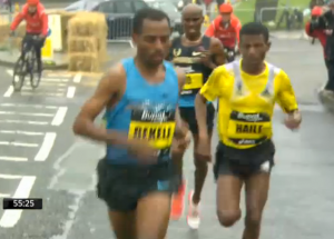 Bekele makes his move on downhill and then uphill leading to 12th mile mark