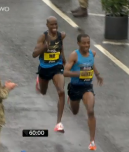 Kenenisa Bekele and Mo Farah battling with less than 10 seconds remaining