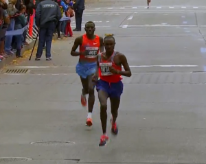 Geoffrey Mutai Pulls away from Stanley Biwott just before mile 23