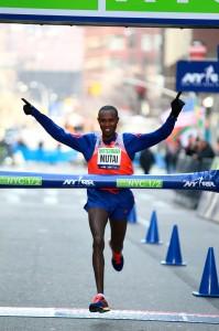 Geoffrey Mutai of Kenya wins the 2014 NYC Half in 1:00:50 on March 16. (PhotoRun/NYRR)