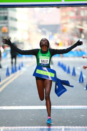Kipyego, shown here winning the NYC Half in 2014, is the class of this field on paper