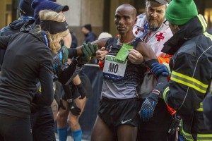 Mo Farah Coming To After Passing Out at NYC Half Full photo gallery here: https://www.letsrun.com/photos/2014/nyc-half/