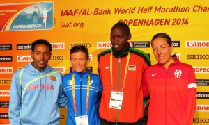 Eritrea's Zersenay Tadese, Italy's Valeria Straneo, Kenya's Wilson Kiprop and Denmark's Jessica Petersson in advance of the 2014 IAAF World Half-Marathon Championships in Copenhagen (photo by David Monti for Race Results Weekly)