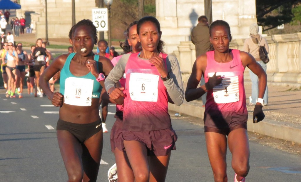 Aliphine Tuliamuk-Bolton, Mamitu Daska and Janet Bawcom lead field in the second mile of the 2014 Credit Union Cherry Blossom Ten Mile Run; Sara Hall and Makida Abdela are partially obscured behind them (photo by David Monti)