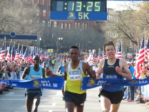 Ethiopia's Dejen Gebremeskel breaks to the tap to win the 2014 B.A.A. 5-K in an event record 13:26, just beating Kenya's Stephen Sambu (l) and American Ben True (r). (photo by Jane Monti for Race Results Weekly)