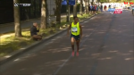 Bekele motioning to his hamstring