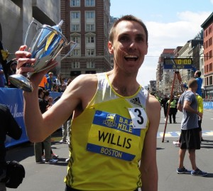 Nick Willis shows of his trophy after winning the 2014 B.A.A. Invitational Mile (photo by Jane Monti for Race Results Weekly)