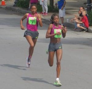 Lucy Kabuu of Kenya (r) sprints away from Mamitu Daska of Ethiopia to win the 2014 Freihofer's Run for Women 5-K in 15:20.1