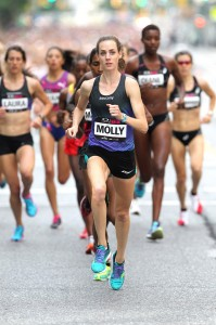 Molly Huddle, 29 of Providence RI takes an early lead and will win the Oakley New York Mini 10K in Central Park in a time of 31:37 (new American 10K record for a women's only race) on Saturday, June 14, 2014. Photo courtesy of PhotoRun/NYRR.