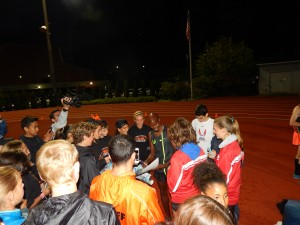 Mo Farah swarmed for autographs after the meet