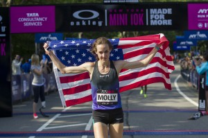 Molly Huddle (USA) wins the 2014 Oakley Mini in an American record in Central Park, NY.  (Courtesy of NYRR)