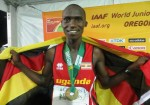 Joshua Cheptegei celebrates after winning the gold medal at 10,000m at the 2014 IAAF World Junior Championships (photo by Chris Lotsbom for Race Results Weekly)