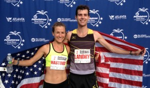 Amy Hastings with Christo Landry after they won July's Peachtree Road Race