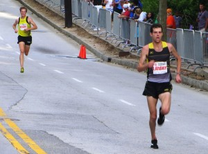 Christo Landry pulls away from Tyler Pennel. Photo by Chris Lotsbom.