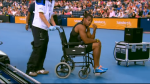 Yohan Blake is wheeled off the track in Glasgow in 2014