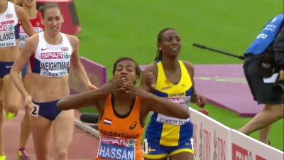 Hassan blew kisses to the crowd upon crossing the finish line