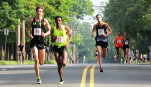 PHOTO: Luke Puskedra, Girma Mecheso and Christo Landry fight for the win at the 37th annual Faxon Law New Haven Road Race  (photo by Jane Monti for Race Results Weekly).