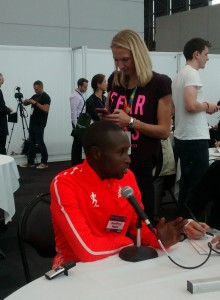 Geoffrey Mutai with Paula Radcliffe in the Background
