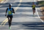 Sam Chelanga (left) pulls away from Aaron Braun to win the 2013 Manchester Road Race (Photo by Jane Monti for Race Results Weekly)