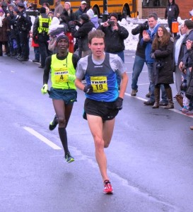 Sam Chelanga (l) and Ben True battle in the final sprint at the 2014 Manchester Road Race (photo by Jane Monti for Race Results Weekly)