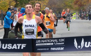 Brian Shrader winning his first USA road running title at the 2014 .US 12-K Championships in an American record 34:11  (photo by Jane Monti for Race Results Weekly)