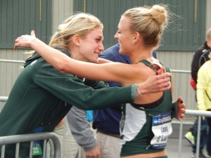 Rachele Schulist embraces Leah O'Connor after the latter's NCAA steeple title in June