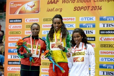 Obiri (left) on the podium after her silver at World Indoors with fellow medallists Genzebe Dibaba and Maryam Yusuf Jamal.