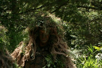 Occasionally, Cormier donned a ghillie suit in his work as a sniper.