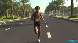 Tufa all alone out in front with a number and not her name on the her bib
