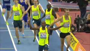 Jeremiah Mutai celebrates as the top guys all share the same singlet