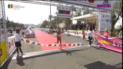 Chelimo crosses the line (the clock was showing the men's time)