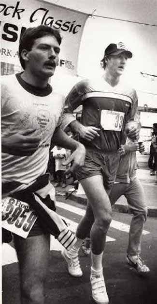 Larry Bird racing in velcros