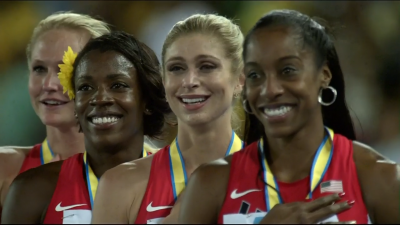Four happy faces during The Star-Spangled Banner