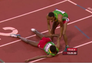 Kejelcha (on ground) was exhausted after winning World Juniors at Hayward last year