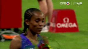 Ayana smiles after running 14:14