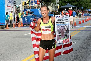 Amy Hastings celebrating her 2014 Peachtree win. *2014 AJCPeachtree Photos