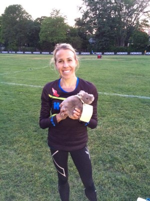 A happy Nicole Tully with her prize -- a rhino doll