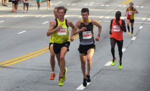 Aaron Braun, Tyler Pennel, Christo Landry, Shadrack Biwott and Jake Riley competing at the 2014 AJC Peachtree Road Race which hosted the USA 10-K road running championships that year (photo by Chris Lotsbom for Race Results Weekly)