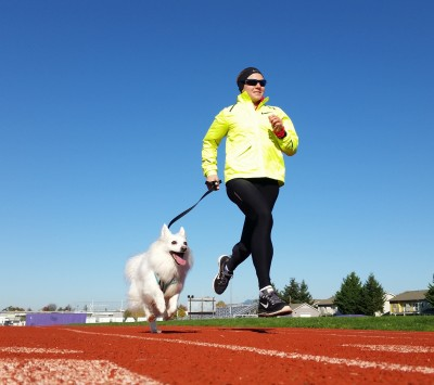 Johnson running with one of her favorite training partners: her American Eskimo, Luna (Photo courtesy Nick Johnson)