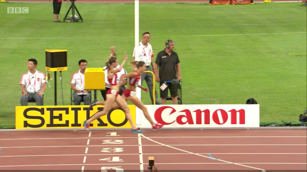 Molly Huddle gives the bronze to Emily Infeld