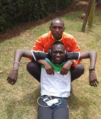Koech casually relaxing with some 800 runner (photo from Koech's Facebook page)