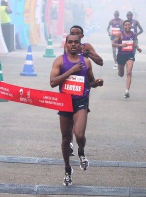 Birhanu Legese wins. Photo courtesy of Airtel Delhi Half Marathon.